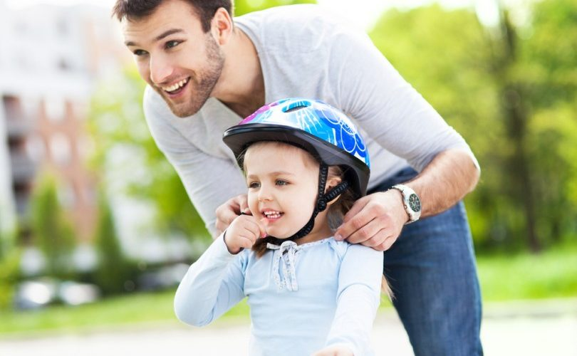 Father-and-daughter-biking-810x540